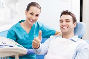 happy patient and dentist after ridge augmentation