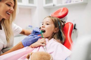 girl learning about pediatric dentistry